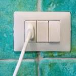 Plug in a wall socket — Stock Photo #77894416