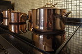 Copper cookware In A Row — Stock Photo