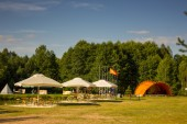 Tents in the tourist camp in a forest glade. — Stock Photo