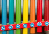 Multicolored strips of  xylophone with notes. — Stock Photo
