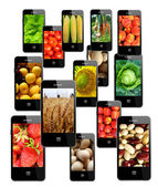 Modern mobile phones with different images — Stock Photo