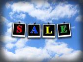 Inscription sale on the background of sky — Stock Photo