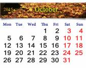 Calendar for October of 2015 with the yellow leaves — Photo