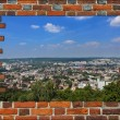 Broken wall from red brick and view to the city — Stock Photo #60091921