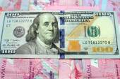 American dollars on the grivnas banknotes' background — Stock Photo