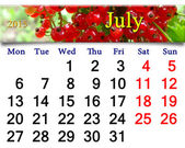 Calendar for July of 2015 year with red berry — Stock Photo