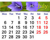 Calendar for July of 2015 year with flowers of bluebells — Stock Photo