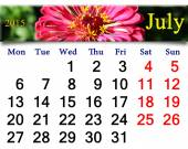 Calendar for July of 2015 year with red zinnia — Stock Photo