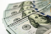 Hundred dollar bank notes isolated on the white — Stock Photo