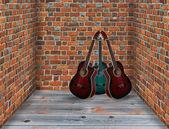 Three guitars in the corner of the room — Stock Photo