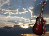 Classic guitar on the sunset's background — Stock Photo