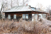 Old rural house covered by hoar-frost — Stock Photo
