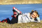 Young girl in roller skates lays on the ground — Stock Photo