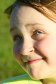 Portrait of little squinting girl with nice face — Stock Photo