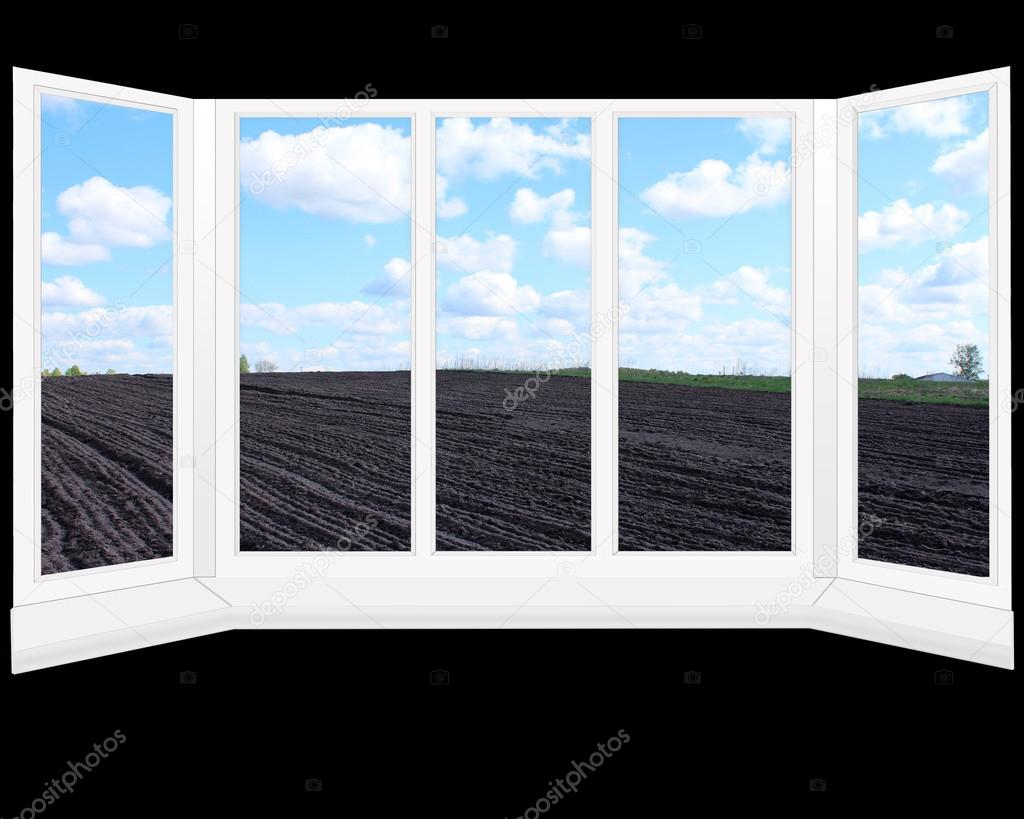 Blick aus dem fenster land  Fenster mit Blick auf Gepflügtes Land bereit für die Bepflanzung ...