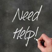 Hand Writing 'Need Help' — Stock Photo