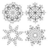 Decoratieve rozetten of sneeuwvlokken — Stockvector