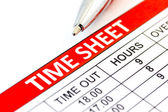Compiled Time sheet with a pen — Stock Photo