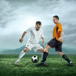 Two football players with ball — Stock Photo #54461561