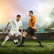 Two football players with ball — Stock Photo #54461789