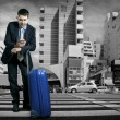 Man with baggage speaking on phone — Stock Photo #54461945