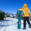 Man stay with snowboard — Stock Photo #54462471