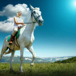 Young horsewoman riding on horse — Foto Stock #54462689