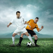Two football players with ball — Stock Photo #54463869