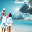 Happy young family on beach — Stock Photo #54463953