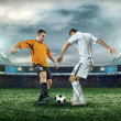 Two football players with ball — Stock Photo #54464235