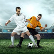 Two football players with ball — Stock Photo #54464249