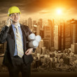 Architect in protective helmet — Stock Photo #54464261