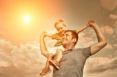 Son sitting on father — Stock Photo