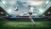 Football player with ball — Stock Photo