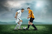 Soccer players with ball — Stock Photo