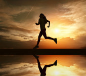 Beautiful silhouette of female running — Zdjęcie stockowe