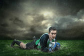 Football goalkeeper with ball — Stock Photo