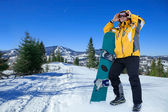 Men in goggles with snowboard — Stock Photo