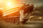 Military tank and soldier outdoors. — Stock Photo