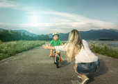 Mother and son on bicycle — Stock Photo