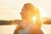 Female running under sunlight — Stock Photo