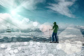 Skier stay on the peak of mountain — Stock Photo