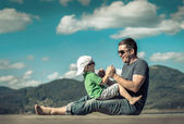 Happiness father and son on the pier — Stock Photo