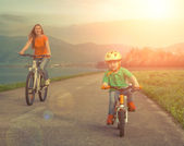 Mother and son on the bicycles — Stock Photo