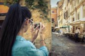 Female tourist shoot by phone in Roma — Stock Photo
