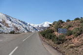 Road through snow covered Atlas mountains in Morocco — Stock Photo