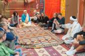 Moroccan rug sellers showing traditional berber carpets to tourists. Morocco, Africa — Stock Photo