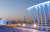 Dubai Meydan Bridge illuminated at night. Dubai, United Arab Emirates — Stock Photo