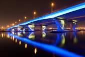 Blue illuminated Al Garhoud Bridge in Dubai, United Arab Emirates — Stock Photo