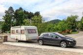 Car with a caravan on the road in southern France — Stock Photo